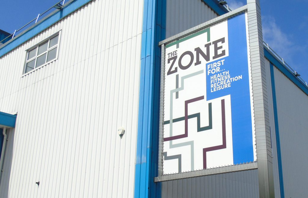 The Zone tension banner